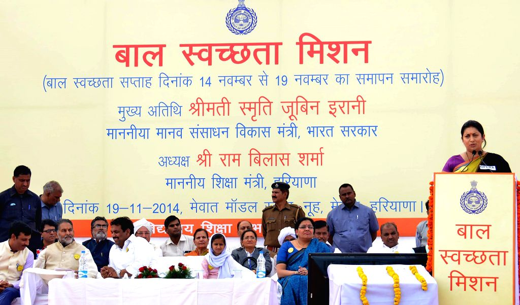 Union HRD Minister Smriti Irani addresses during her visit to a school in Mewat District, Haryana on Nov 19, 2014.