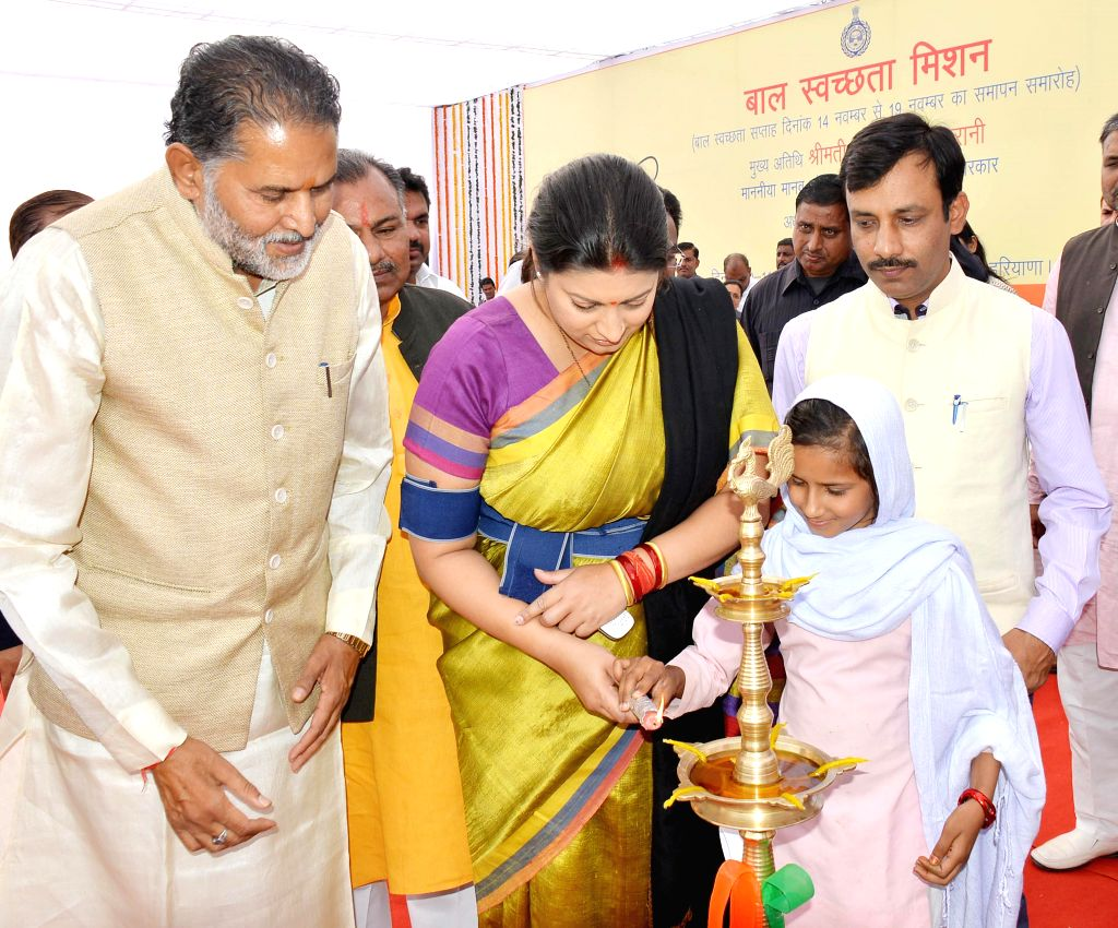 Union HRD Minister Smriti Irani inaugurates a programme at a school in Mewat district of Haryana on Nov 19, 2014.