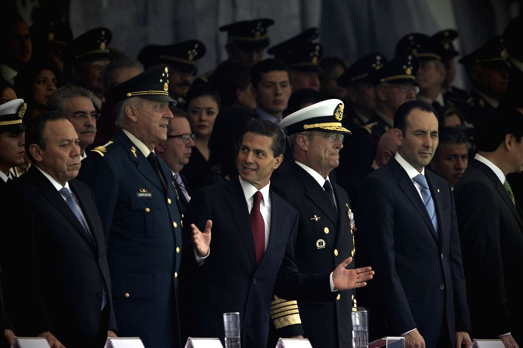 Mexican President Enrique Pena Nieto (3rd L) takes part in the ceremony of delivery of awards and promotions in a celebration of the 105th anniversary of the ...