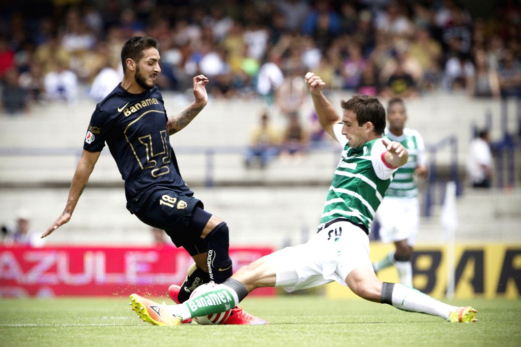 UNAM's Pumas Ismael Sosa (L) vies for the ball with Santos' Carlos Izquierdoz during the match of Closing Tournament of the MX League, held in the Olympic ...