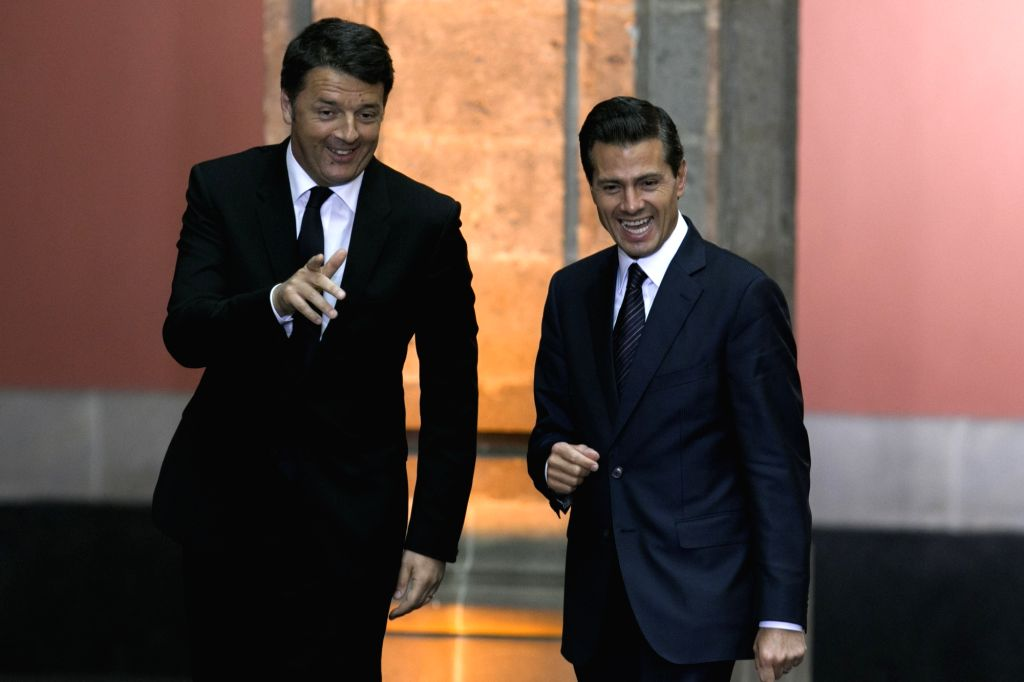 MEXICO CITY, April 21, 2016 - Mexican President Enrique Pena Nieto (R) and Italian Prime Minister Matteo Renzi gesture during a joint press conference in Mexico City, capital of Mexico, on April 20, ... - Matteo Renzi