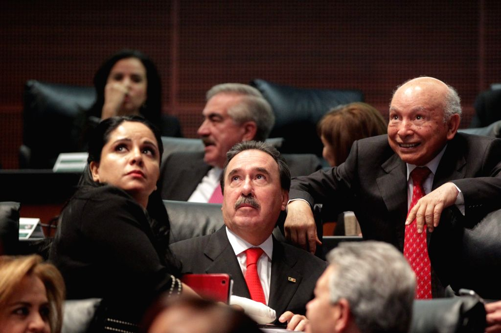 The senator of the Institutional Revolutionary Party Emilio Gamboa Patron (C) reacts during the vote of the political reform of the Federal District at the ...