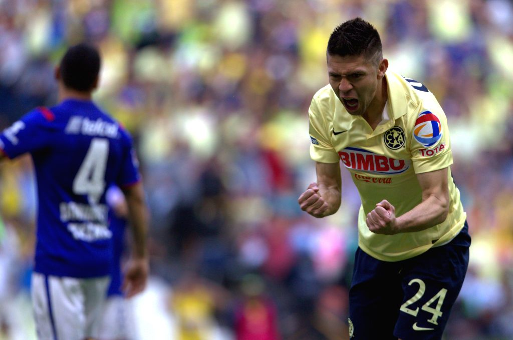 America's Oribe Peralta celebrates his score during the match of the 2015 Closing Tournament of the MX League against Cruz Azul, in the Azteca Stadium, in ...