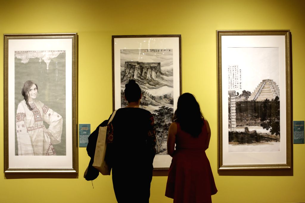 "MEXICO CITY, Aug. 16, 2019 - People view exhibits at ""Art and Peace: Contemporary Chinese Works"" exhibition at Mexico's National Museum of Cultures in Mexico City, capital of Mexico, Aug. ..."
