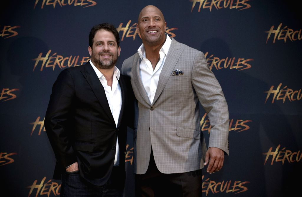 """U.S. actor Dwayne Johnson (R), or """"The Rock"""", and U.S. director Brett Ratner pose during an event to promote their new movie Hercules in Mexico City, ."""