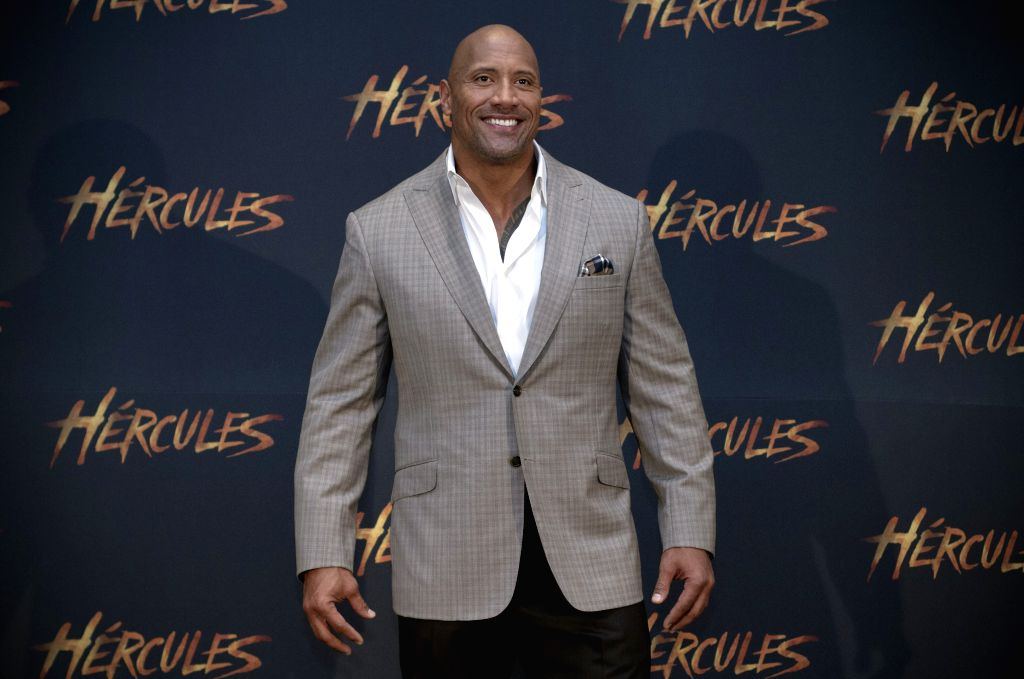 """U.S. actor Dwayne Johnson, or """"The Rock"""", reacts during an event to promote his new movie Hercules in Mexico City, capital of Mexico, on Aug. 18, 2014."""
