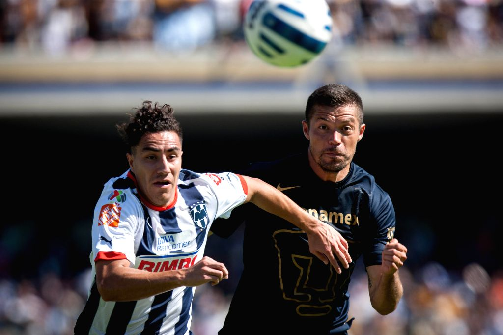Mexico City: Dante Lopez (R) of UNAM's Pumas vies with Efrain Juarez of Monterrey during the match of the Day 17 of the 2014 Opening Tornament of MX League, in the Olympic Stadium, in Mexico City, ...