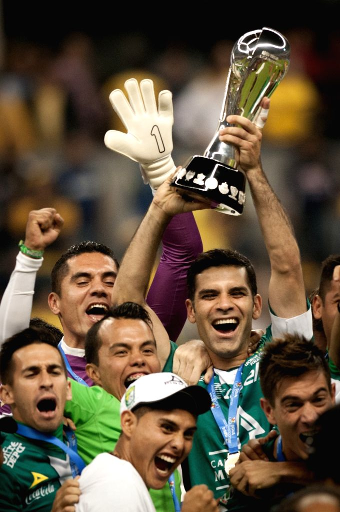 Captain Rafael Marquez of Leon holds up the thropy with team mates after their team won the Mexican league championship final soccer match against America .. - Rafael Marquez