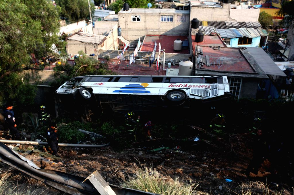 Rescuers work at a bus accident site in Mexico City, capital of Mexico, on Dec. 28, 2014. Xinhua/Str/IANS)