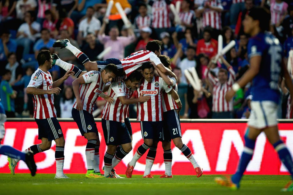 Chivas' players celebrate a score during the match of the 2015 Closing Tournament on MX League against Cruz Azul in the Azul Stadium in Mexico City, capital of ...