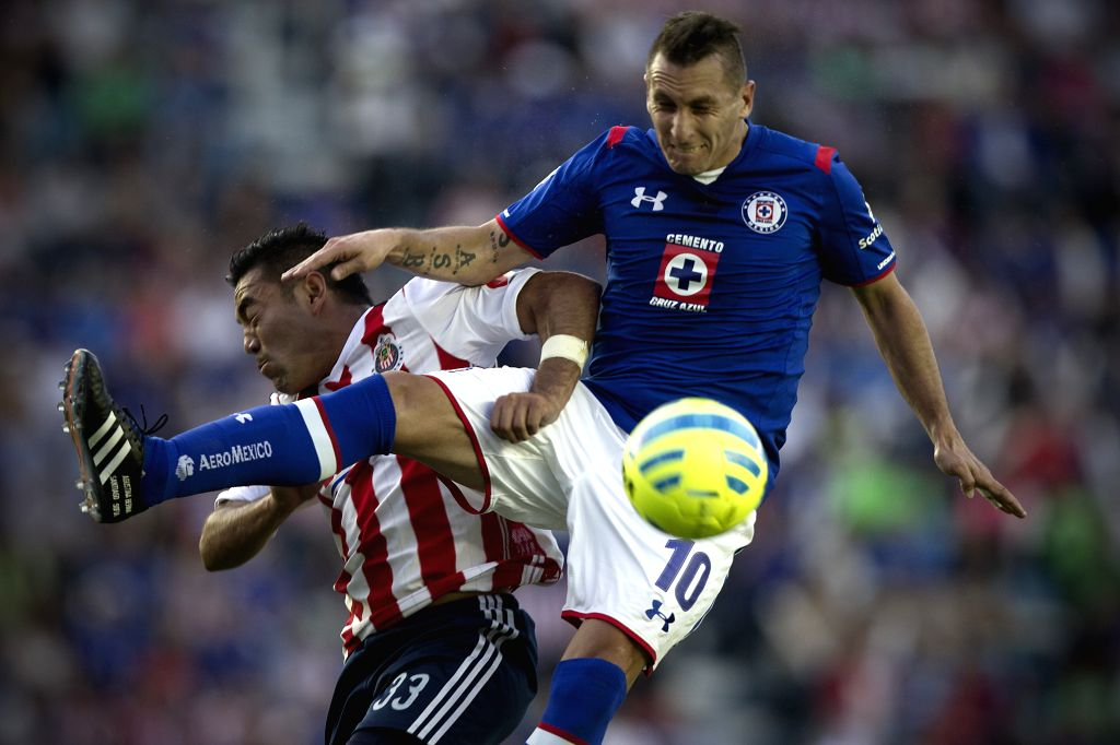 Cruz Azul's Christian Gimenez (R) vies for the ball with Marco Fabian of Chivas during the match of the 2015 Closing Tournament on MX League in the Azul Stadium ...