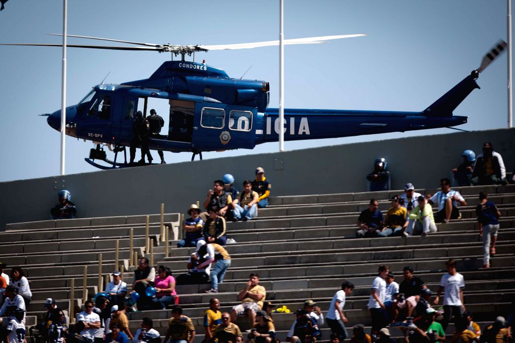 A helicopter of the Secretariat of Public Security of Mexico City stands guard prior to the match of the 2015 Closing Tournament of MX League between UNAM's ...