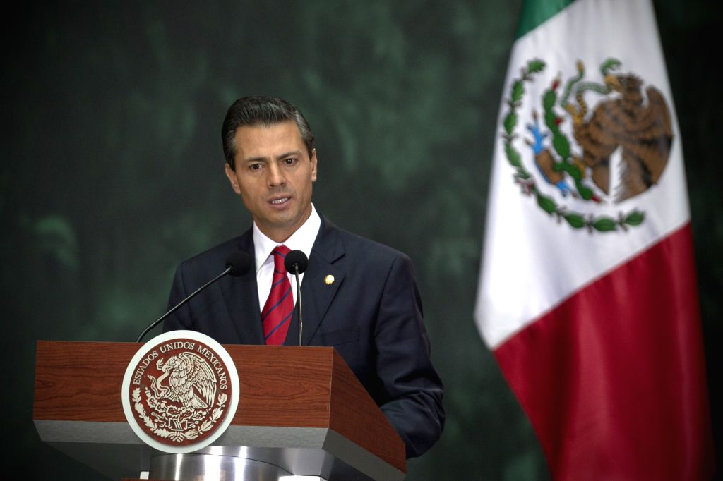 Mexican President Enrique Pena Nieto attends a joint press conference with Peruvian President Ollanta Humala, at National Palace in Mexico City, capital of ...