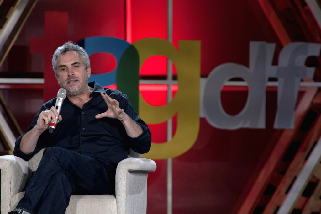 MEXICO CITY, July 3, 2013 (Xinhua/IANS) -- Mexican film director Alfonso Cuaron participates in a press conference during the TagDF Festival, held in Mexico City, capital of Mexico, on July 3, 2013. The festival, opened on Wednesday, is one of the bi - Alfonso Cuaron