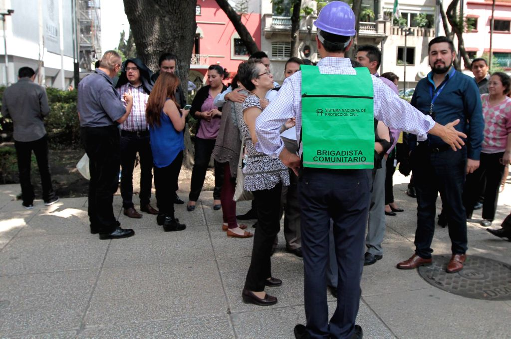 MEXICO CITY, June 28, 2016 - People gather outdoors after getting a seismic alert in Mexico City, capital of Mexico, on June 27, 2016. A 5.4-magnitude earthquake jolted south Mexico on Monday, with ...