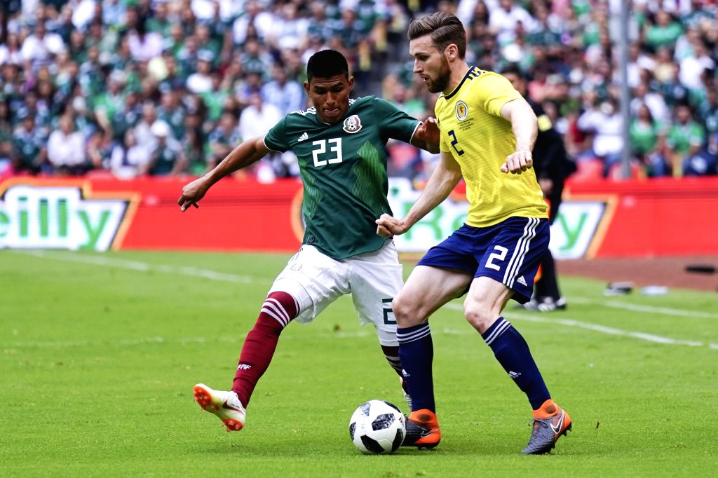 MEXICO CITY, June 3, 2018 - Mexico's Jesus Gallardo (L) vies for the ball with Scotland's Stephen O'Donnell during the international friendly match before the 2018 FIFA World Cup in Mexico City, ...