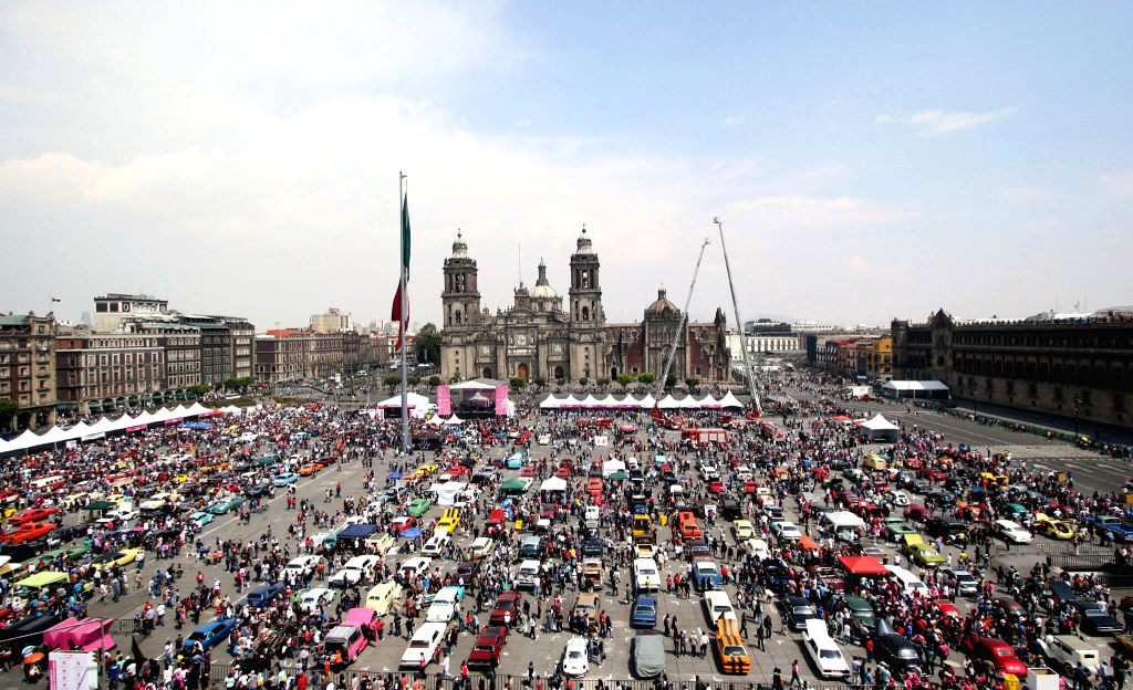 MEXICO CITY, March 13, 2017 - People view exhibited cars during a charity event in Mexico City, capital of Mexico, March 12, 2017. More than 600 cars were displayed in the event, which was held to ...
