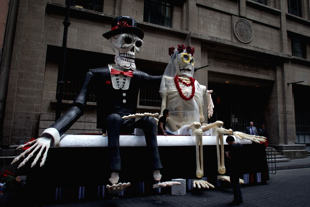 Employees arrange props for the filming of the new James Bond movie Spectre in the downtown of Mexico City, capital of Mexico, on March 18, 2015. ...