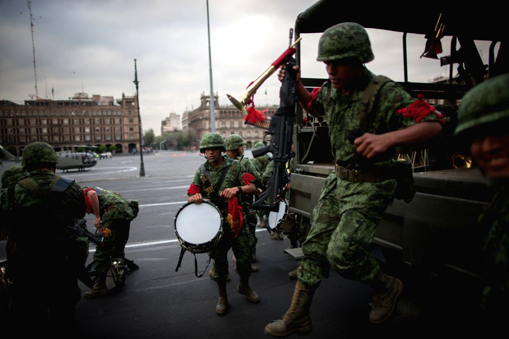 Soldiers of the Mexican Army get down of a military vehicle during the rehearsals for the filming of the new James Bond movie Spectre, at the Historical ...