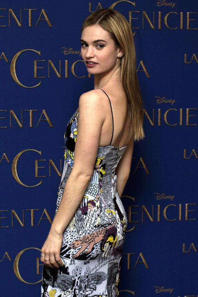 """Actress Lily James poses during a photocall to promote the movie """"Cinderella"""" in Mexico City, capital of Mexico, on March 6, 2015. (Xinhua/Alejandro ... - Lily James"""