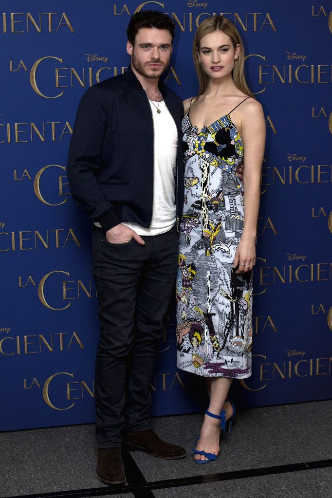 """Lily James (R) and Richard Madden pose during a photocall to promote the movie """"Cinderella"""" in Mexico City, capital of Mexico, on March 6, 2015. ..."""