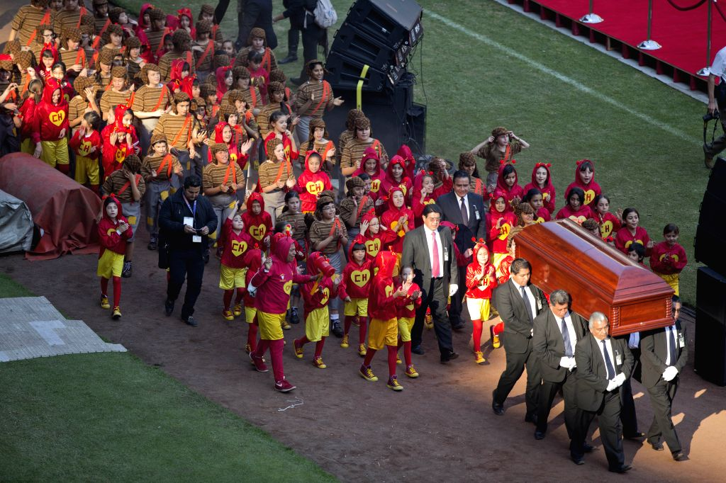 """Mexico City (Mexico): People move the coffin of Mexican comedian Roberto Gomez Bolanos known as """"Chespirito"""", during the homage service in honor of the comedian, in the Azteca Stadium, in .."""