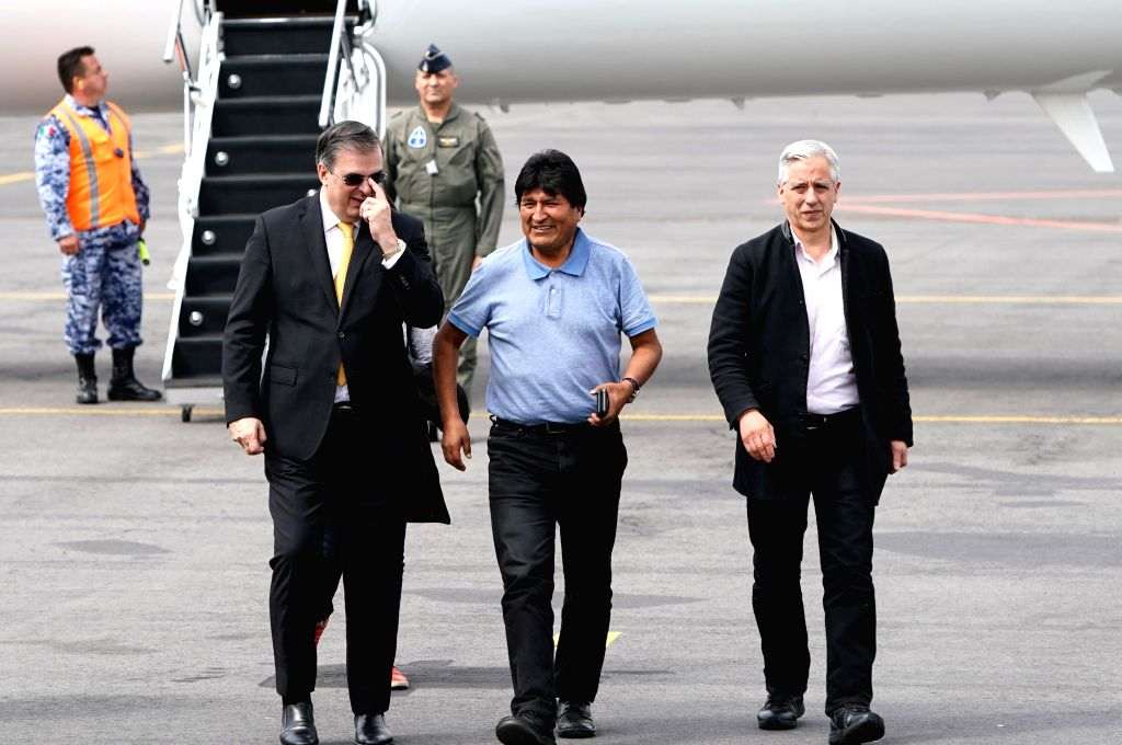 MEXICO CITY, Nov. 12, 2019 - Evo Morales (front, C) is welcomed by Mexican Foreign Minister Marcelo Ebrard (front, L) upon his arrival at the airport in Mexico City, capital of Mexico, on Nov. 12, ... - Marcelo Ebrard