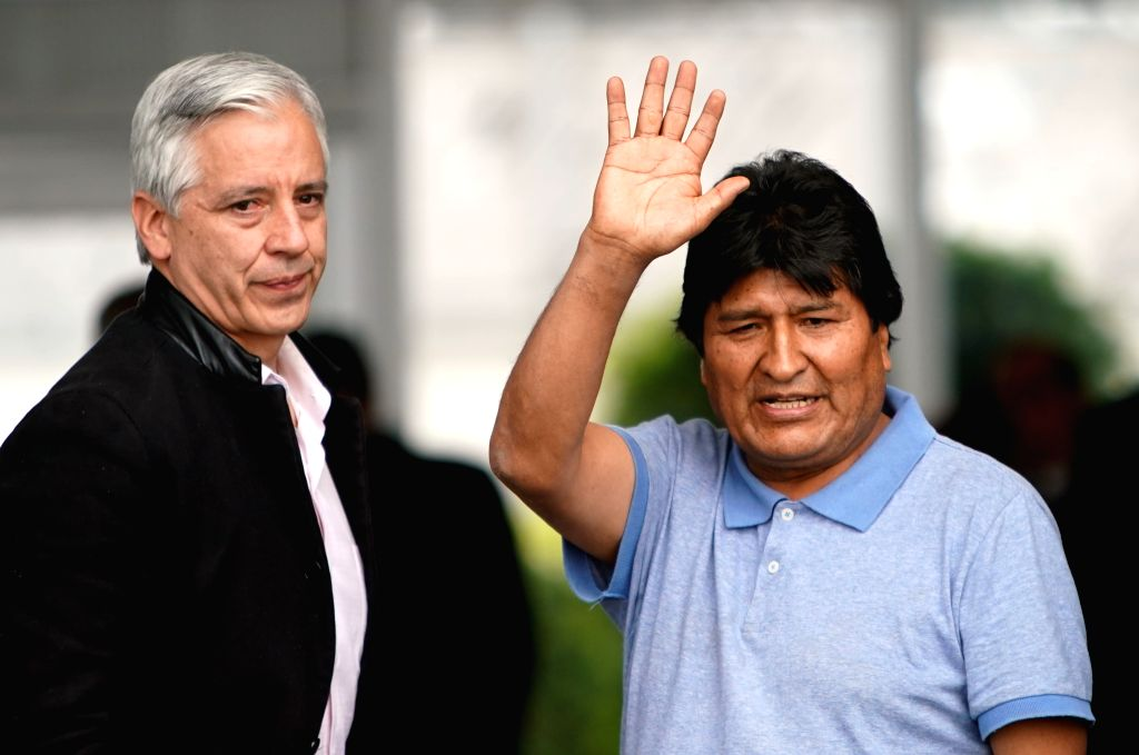 MEXICO CITY, Nov. 12, 2019 - Evo Morales (R) waves upon his arrival at the airport in Mexico City, capital of Mexico, on Nov. 12, 2019. Evo Morales, who had been offered political asylum by the ...