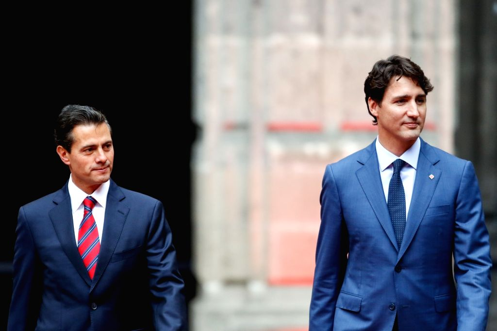MEXICO CITY, Oct. 13, 2017 - Mexican President Enrique Pena Nieto (L) welcomes Canadian Prime Minister Justin Trudeau in Mexico City, Mexico, on Oct. 12, 2017. Canadian Prime Minister Justin Trudeau ... - Justin Trudeau