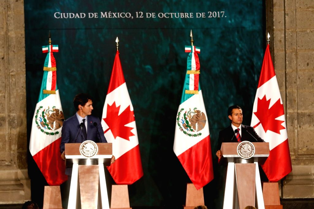 MEXICO CITY, Oct. 13, 2017 - Mexican President Enrique Pena Nieto (R) and Canadian Prime Minister Justin Trudeau attend a joint press conference in Mexico City, capital of Mexico, on Oct. 12, 2017. - Justin Trudeau