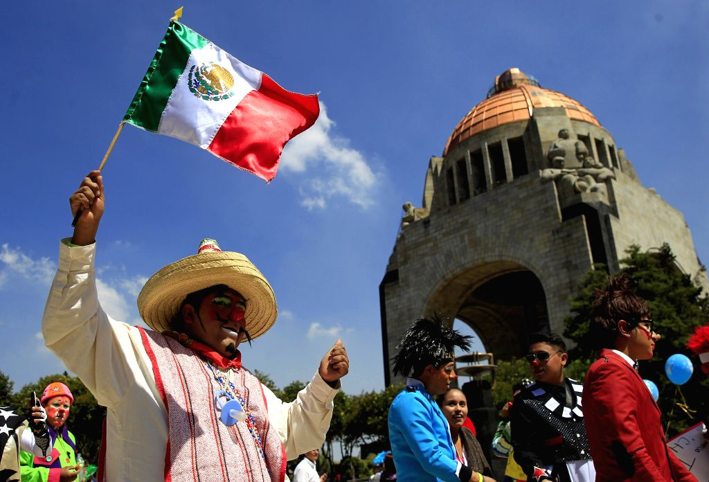 MEXICO CITY, Oct. 20, 2016 - A clown waves the national flag of Mexico during the 21st Clown Convention in Mexico City, capital of Mexico, on Oct. 19, 2016. Over 400 clowns gathered for the ...
