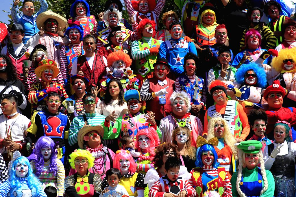 MEXICO CITY, Oct. 20, 2016 - Clowns pose for photo during the 21st Clown Convention in Mexico City, capital of Mexico, on Oct. 19, 2016. Over 400 clowns gathered for the convention.