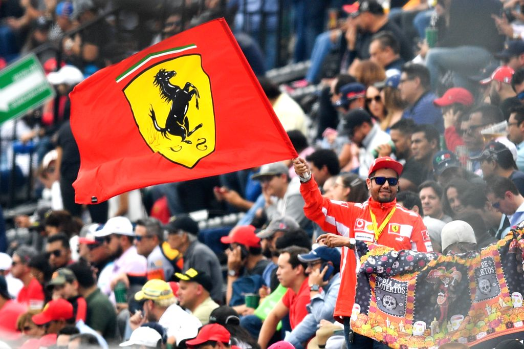 MEXICO CITY, Oct. 26, 2019 - A Ferrari's fan waves the flag during the second practice session of the Formula One Mexico Grand Prix at the Hermanos Rodriguez Circuit in Mexico City, on Oct. 25, 2019.