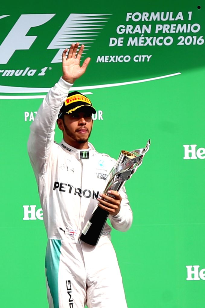 MEXICO CITY, Oct. 31, 2016 - Mercedes' British driver Lewis Hamilton celebrates on the podium after the Formula One Mexico Grand Prix in Mexico City, capital of Mexico, Oct. 30, 2016.