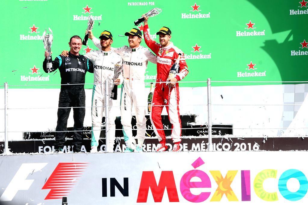MEXICO CITY, Oct. 31, 2016 - Mercedes team coordinator Tony Walton, Mercedes British driver Lewis Hamilton, Mercedes German driver Nico Rosberg and Ferrari German driver Sebastian Vettel (from L to ...