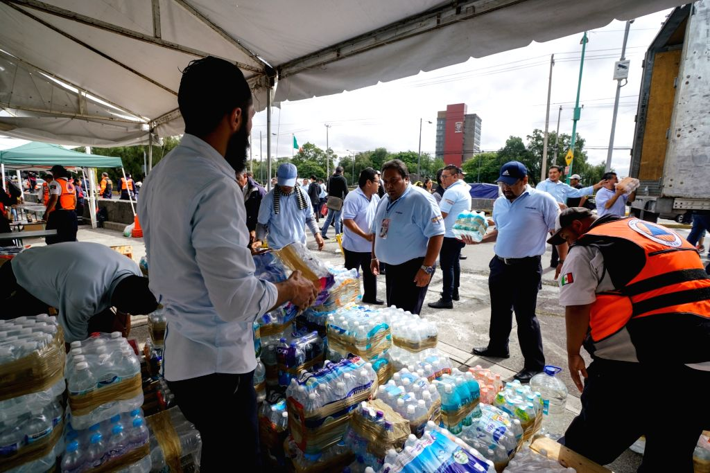 MEXICO CITY, Sept. 11, 2017 - Workers arrange donations for the communities affected by earthquake, in Mexico City, capital of Mexico, Sept. 10, 2017. The number of victims from a strong earthquake ...