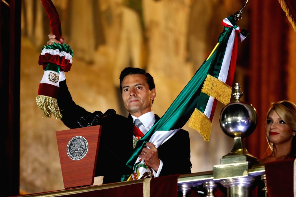 MEXICO CITY, Sept. 16, 2017 - Mexican President Enrique Pena Nieto takes part in the celebration of Mexico's Independence Day at the balcony of the National Palace in Mexico City, capital of Mexico, ...