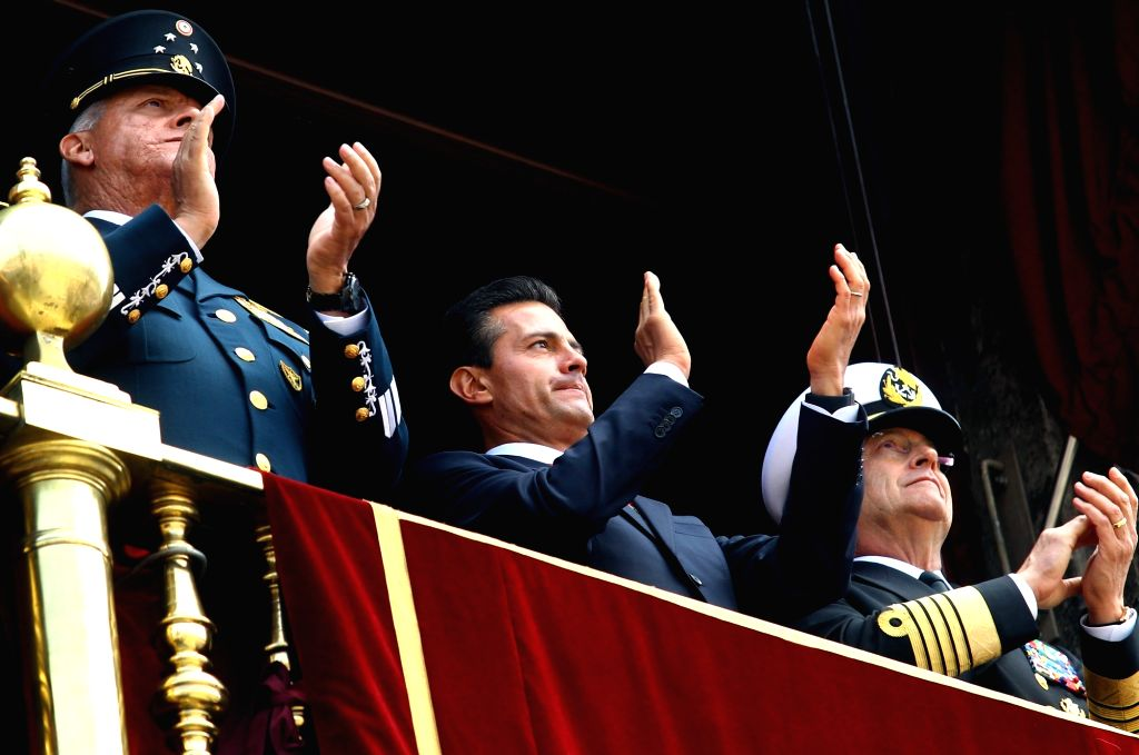 MEXICO CITY, Sept. 16, 2017 - Mexican President Enrique Pena Nieto (C) applaud as he watches the military parade held to commemorate Mexico's Independence Day at the Zocalo Square in Mexico City, ...