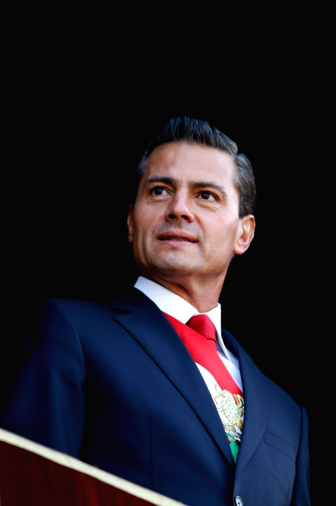 MEXICO CITY, Sept. 16, 2017 - Mexican President Enrique Pena Nieto watches the military parade held to commemorate Mexico's Independence Day at the Zocalo Square, from the National Palace's central ...