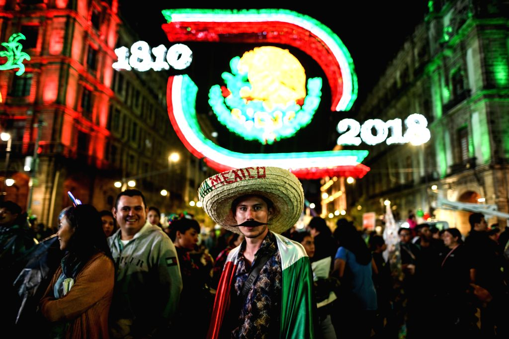 MEXICO CITY, Sept. 16, 2018 - People participate in the celebrations of the 208th anniversary of the Mexican Independence Day, at Zocalo Square, in Mexico City, capital of Mexico, on Sept. 15, 2018.
