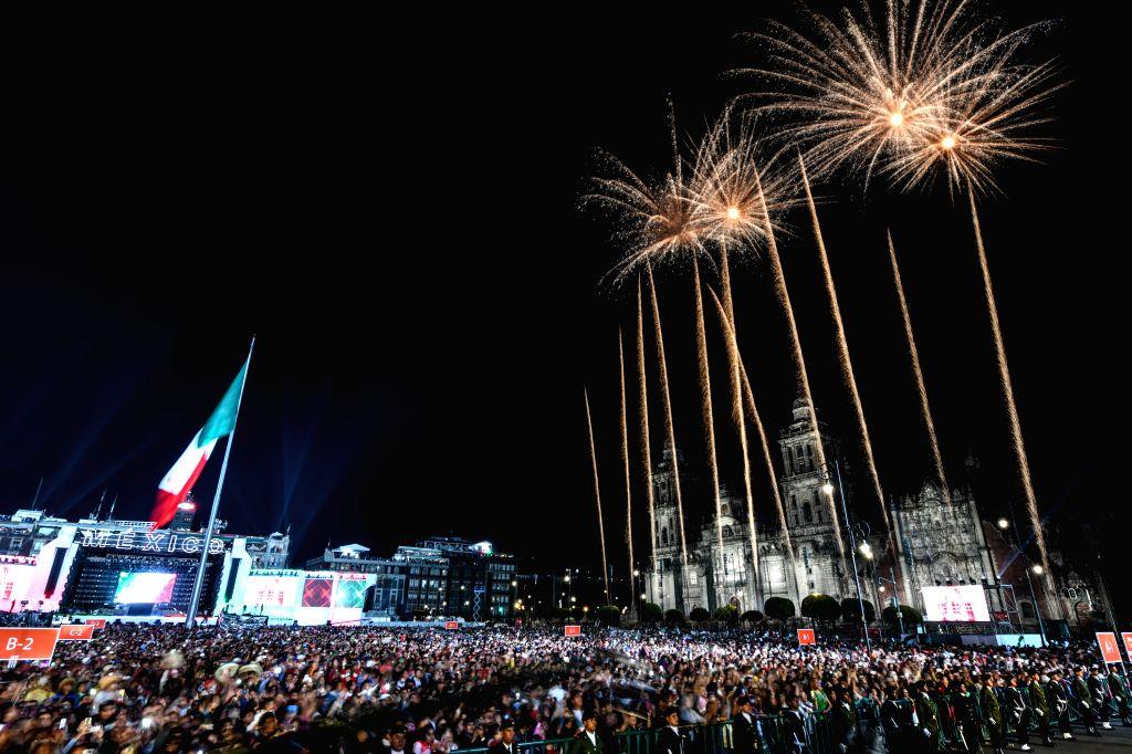 MEXICO CITY, Sept. 16, 2018 - Photo taken on Sept. 15, 2018 shows fireworks over the Metropolitan Cathedral during the celebrations of the 208th anniversary of the Mexican Independence Day, at Zocalo ...