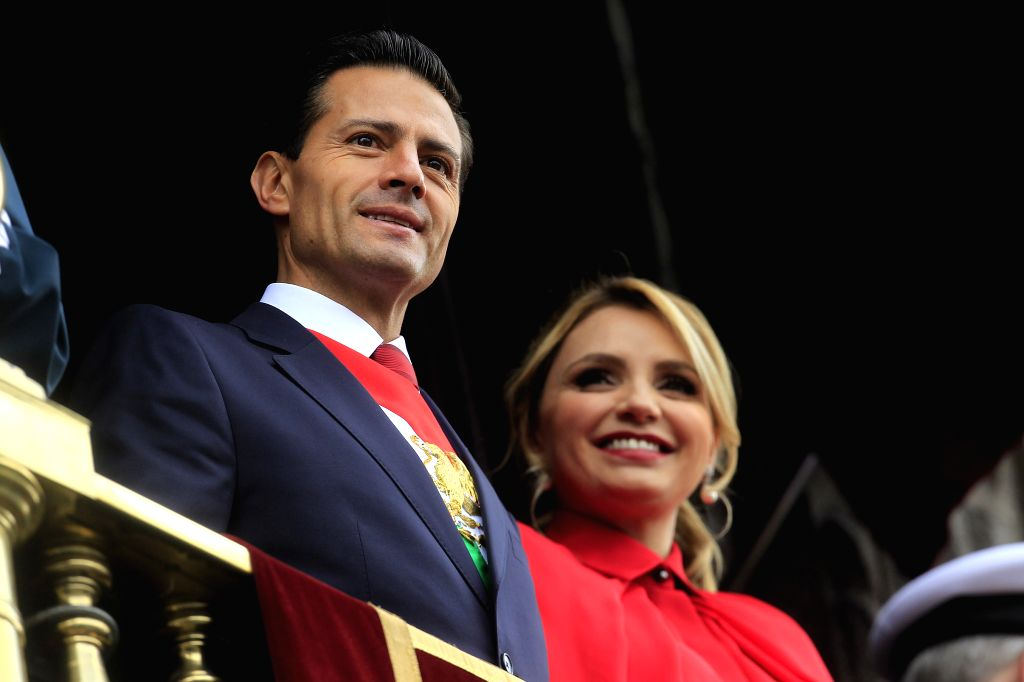 MEXICO CITY, Sept. 17, 2016 - Mexico's President Enrique Pena Nieto (L) and his wife Angelica Rivera attend the parade at the Zocalo Square in Mexico City Sept. 16, 2016. Mexico on Friday held a ...