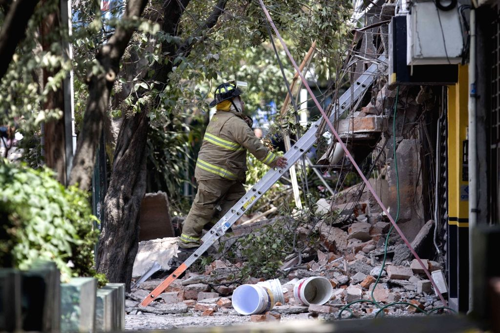 MEXICO CITY, Sept. 20, 2017 - A fireman works on the site of a collapsed building after an earthquake in Mexico City, capital of Mexico, on Sept. 19, 2017. More than 100 people were killed in a ...