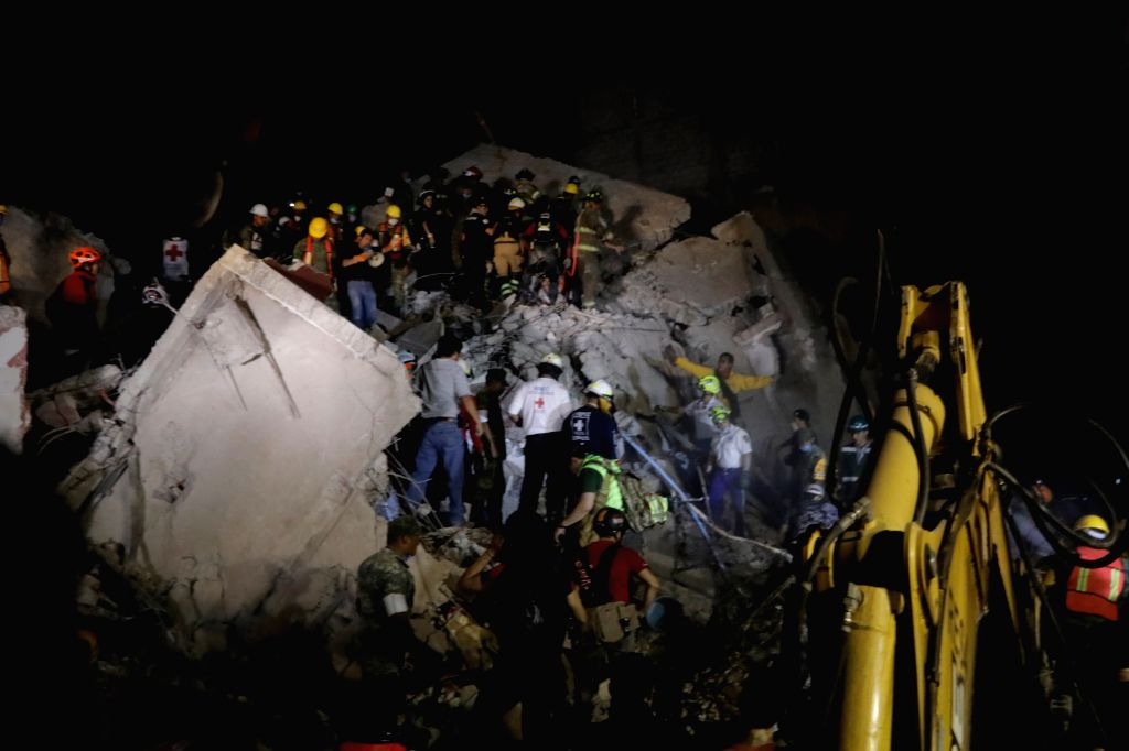 MEXICO CITY, Sept. 20, 2017 - Image taken on Sept. 19, 2017 shows rescuers and volunteers searching for victims in a collapsed building after an earthquake in Mexico City, capital of Mexico. At least ...