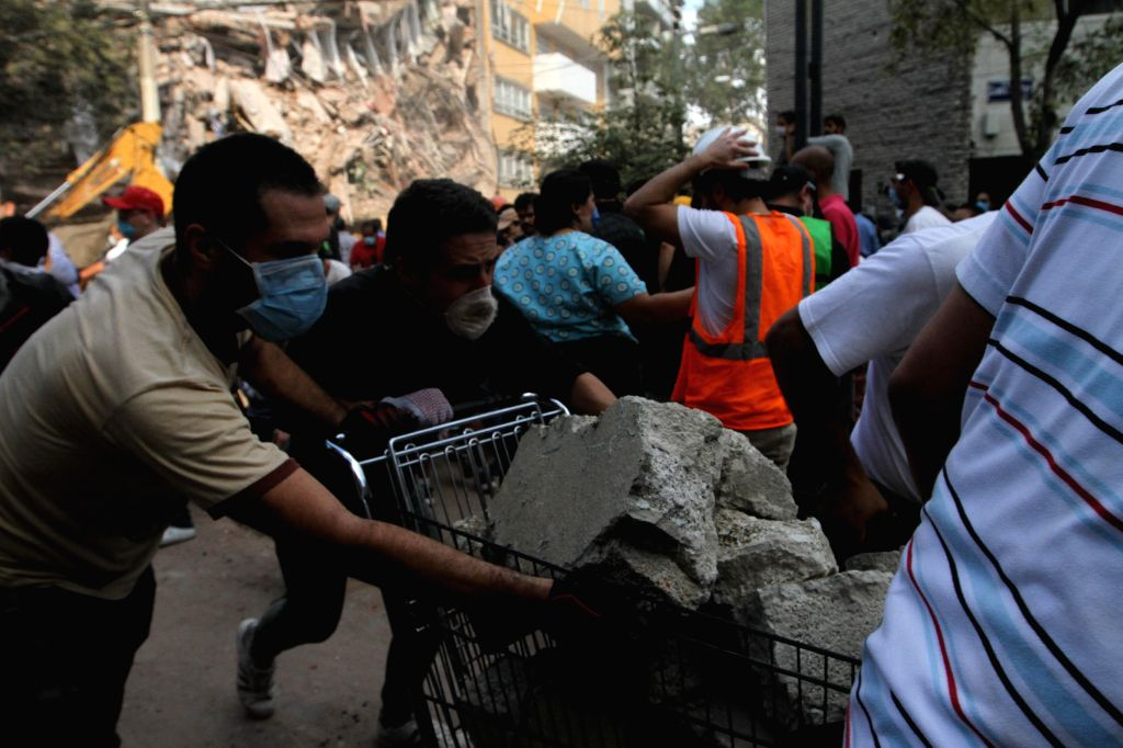 MEXICO CITY, Sept. 20, 2017 - Image taken with a mobile phone shows people searching for victims in a collapsed building after an earthquake in Mexico City, capital of Mexico, on Sept. 19, 2017. More ...