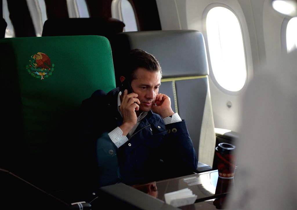 MEXICO CITY, Sept. 20, 2017 - Mexican President Enrique Pena Nieto makes a phone call after an earthquake in Mexico City, capital of Mexico, on Sept. 19, 2017. At least 216 people have been killed ...