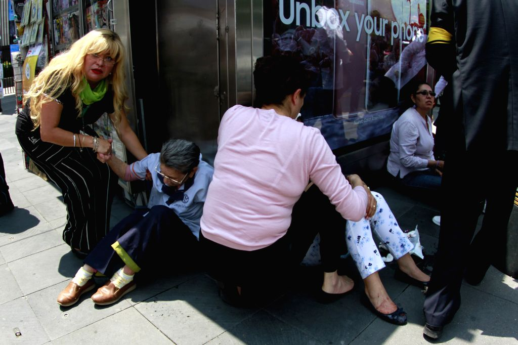 MEXICO CITY, Sept. 20, 2017 - People help each other after an earthquake in Mexico City, capital of Mexico, on Sept. 19, 2017. The death toll from a 7.1-magnitude earthquake that struck central ...