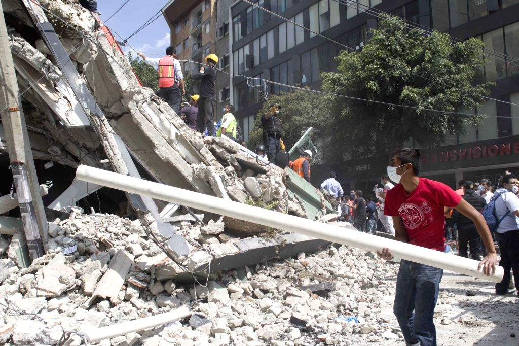MEXICO CITY, Sept. 20, 2017 - People work near a collapsed building after an earthquake in Mexico City, capital of Mexico, on Sept. 19, 2017. More than 100 people were killed in a powerful ...