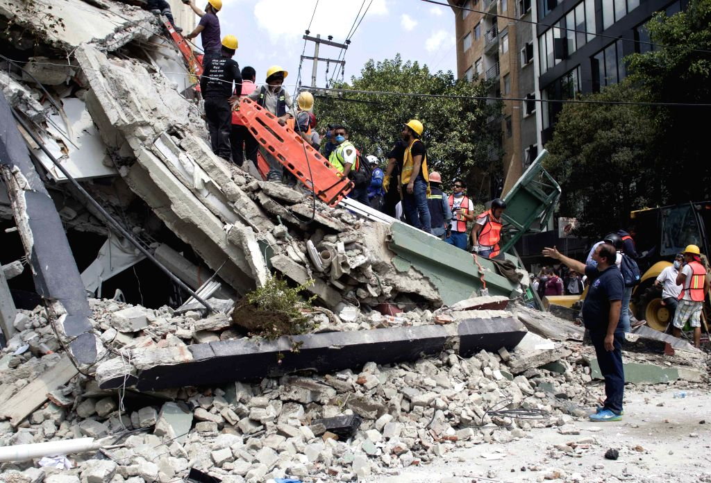 MEXICO CITY, Sept. 20, 2017 - People work on a collapsed building after an earthquake in Mexico City, capital of Mexico, on Sept. 19, 2017. More than 100 people were killed in a powerful ...