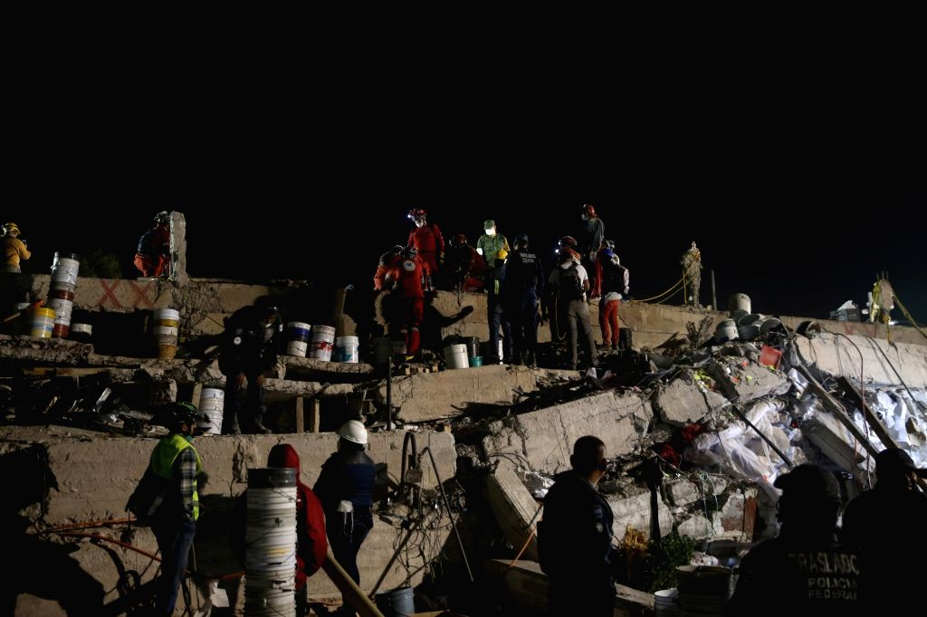 MEXICO CITY, Sept. 20, 2017 - Rescue workers search for survivors after an earthquake, in Mexico City, capital of Mexico, Sept. 20, 2017. A 7.1-magnitude earthquake hit central Mexico on Tuesday.